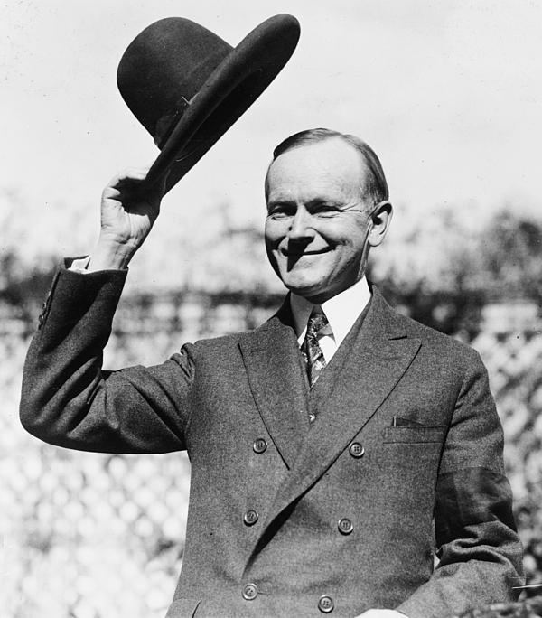 president-calvin-coolidge-tips-is-hat-international-images
